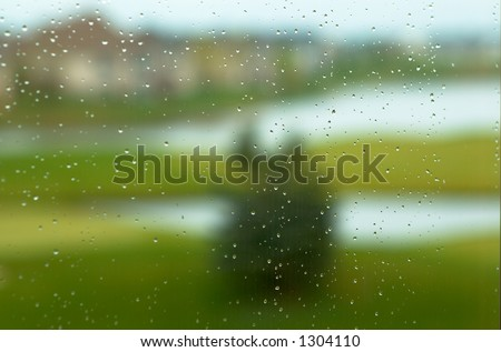 Golf course in the rain. This image has less rain drops but more blurred background.  Can also be a nice background image. This is a photo from A Raining Day Collection. Search keyword Series005.