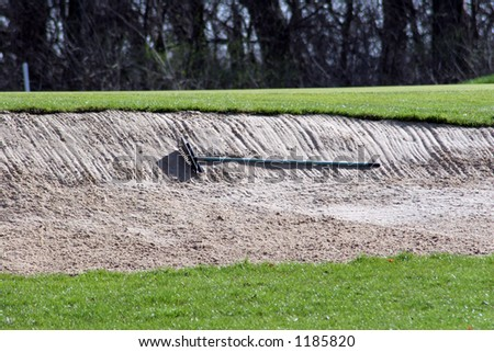 golf course sand trap and rake