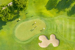 Golf course sport, green grass and trees on a golf field, fairway and putting green top view, Bangkok Thailand. bird view over Golf course in the tropical asia.