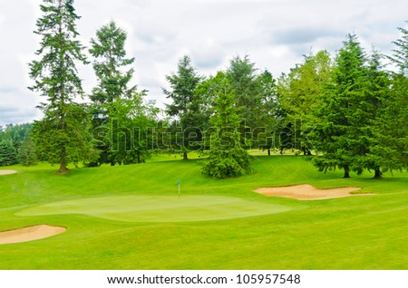Golf course with gorgeous green and sand bunker
