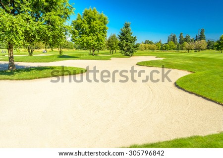 Golf course with gorgeous green and sand bunker - Shutterstock ID 305796842