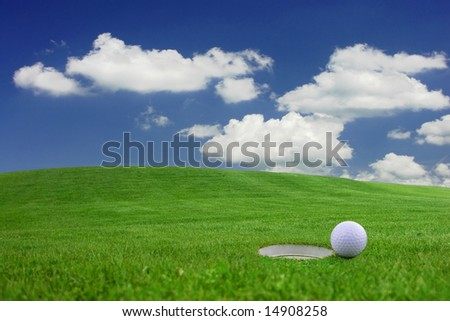 Golf - detail ball with hole on green