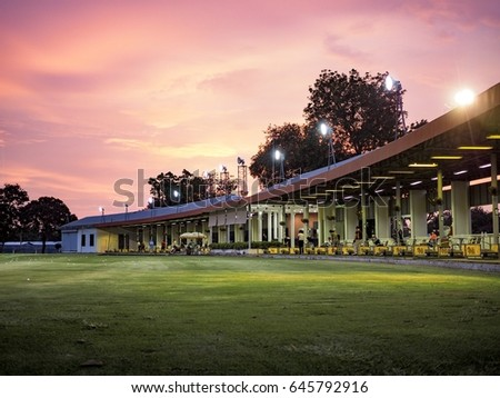 Golf driving range with sunset #645792916