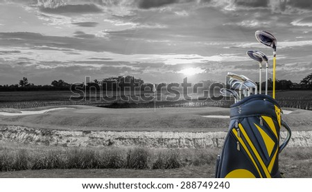 golf equipment and golf bag on green and hole as background.