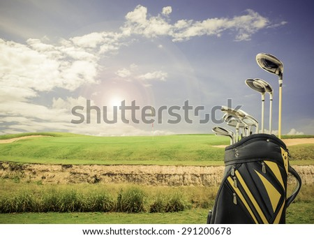 golf equipment and golf bag on green and hole as background.vintage tone