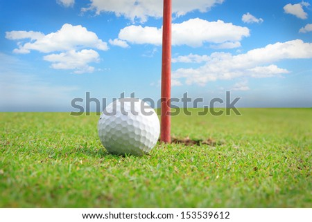 Golf equipment, golf ball with tee on course
