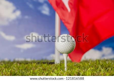 Golf equipment on green grass, golf field