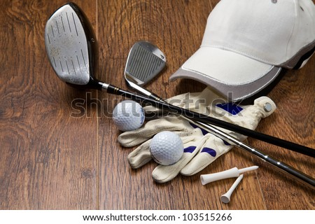 golf equipment on wooden table