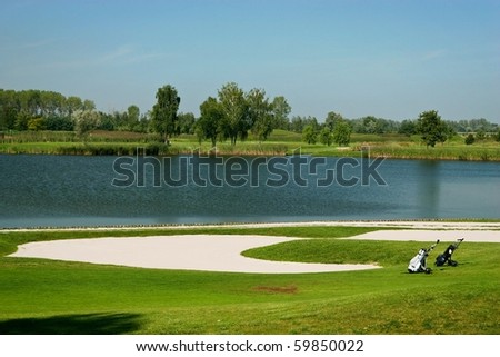Golf field with golf bags
