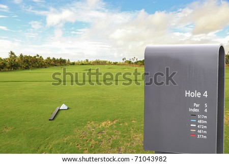 golf field with sign and room for text