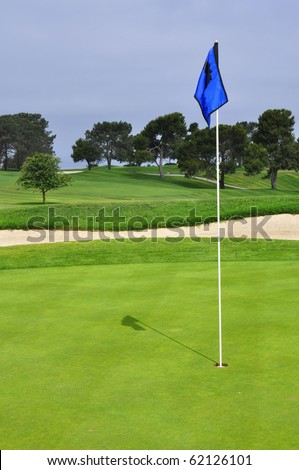 Golf flag on green, room for your text