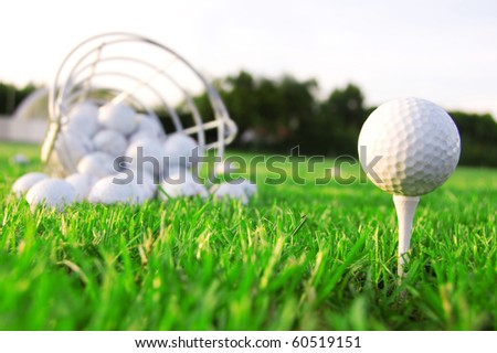 Golf game. Golf balls in grass.
