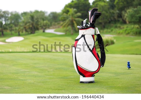 Golf game. Golf clubs in bag against the golf course