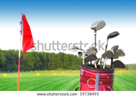 Golf game. Golf clubs in bag against the golf course.