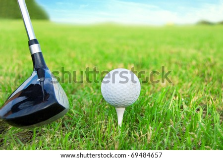Golf game. Hitting the golf ball with club.