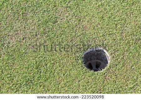 golf hole on green grass, golf course