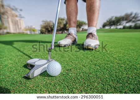 Golf player hit a golf ball with a golf club. Golf courses. Players are trained to play golf on the golf course. Close-up of a golf club and ball