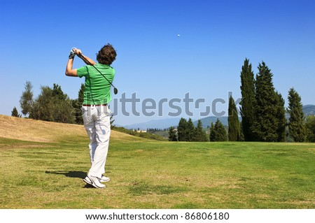 Golf Player hits his ball on the fairway - stock photo