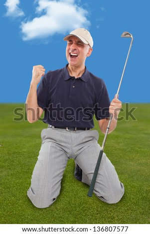 Golf player on knees with club in hand on golf green