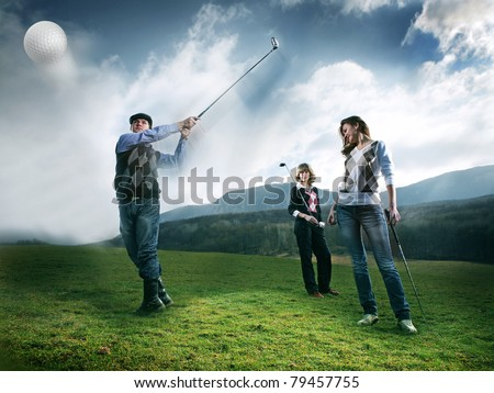 golf player teeing off golf ball from tee box, wonderful cloud formation in background