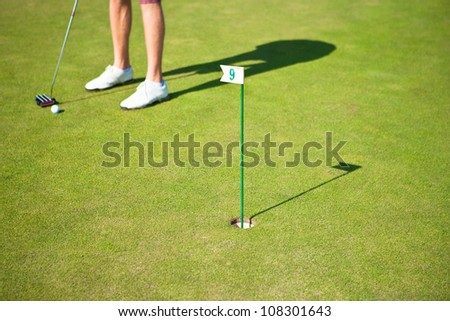 Golf player training a par before actual golf game