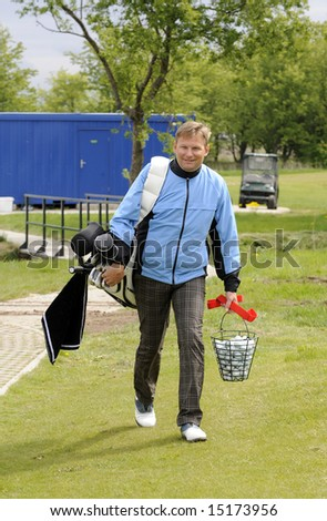 Golf player walk with his club bag and balls