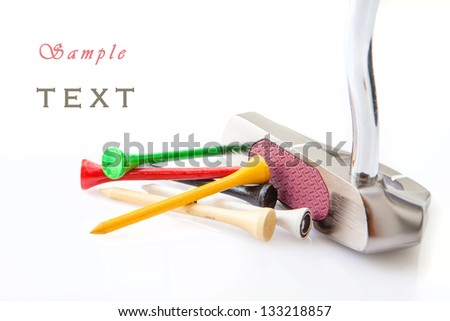 Golf putt and colored sticks on  white background