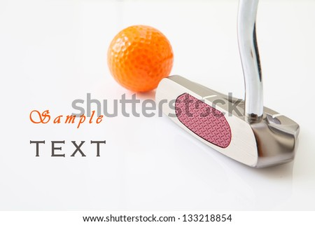 Golf putt and orange ball in white background