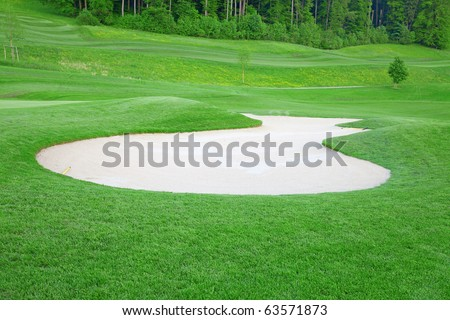 Golf: sand trap on the green grass