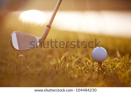 Golf Stick and Ball on the Grass