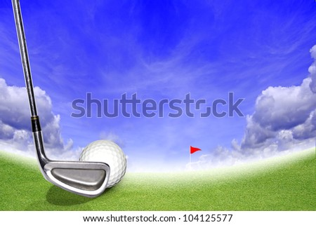 Golf Stick and Ball on the Green Grass and Blue Sky - stock photo