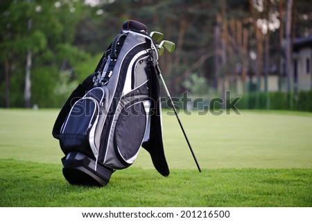 Golf sticks bag standing on golf course