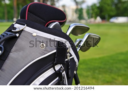Golf sticks in a bag on golf course background