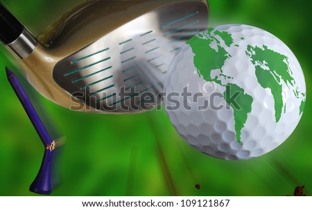 golf world.  Action of golf club or driver hitting golf ball with world map on it with flying golf tee and dirt over blurred green background