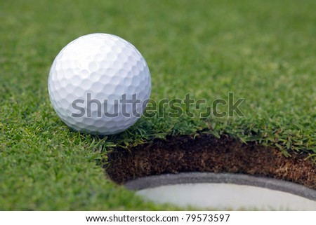 Golfball almost in the hole ストックフォト ©