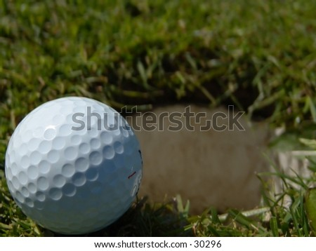 Golfball on the edge of the hole