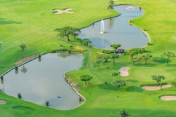 Golfcourse, Beautiful landscape of a golf court with palm trees and green grass.
