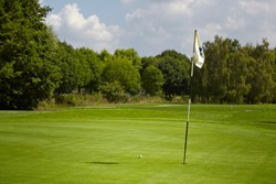 Golfcourse, Beautiful landscape of a golf court with trees and green grass.