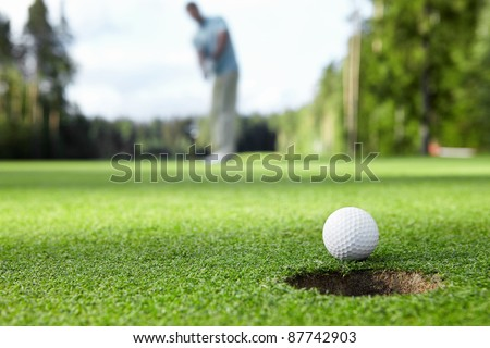 Golfer drove the ball into the hole