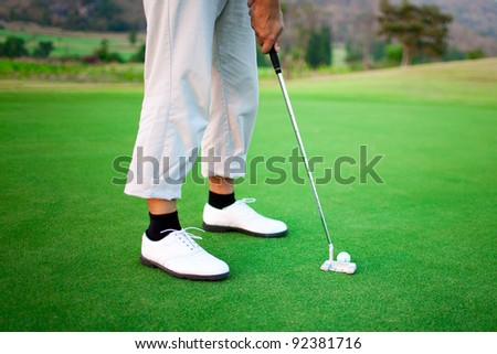 Golfer feet, ball and shoes