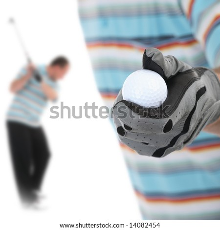 Golfer giving golf ball to caddy