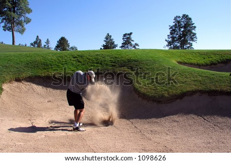 Golfer hitting out of a sand trap (2 of 3 shot action sequence) - stock photo