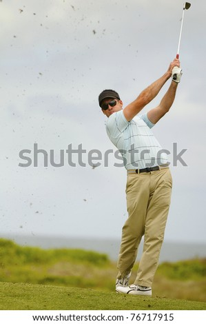 Golfer in action from the fairway