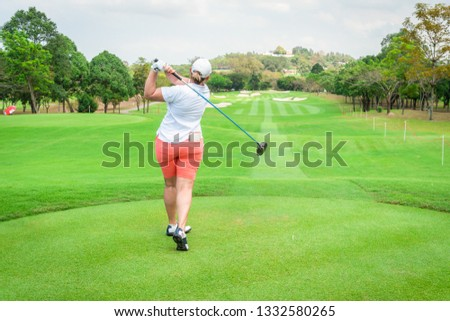 golfer is teeing off golf ball by golf club from tee boxes at golf course in golf competition game