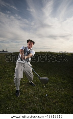 Golfer missing the ball in the rough.