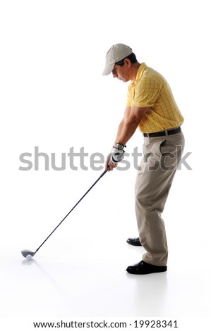 Golfer ready to swing isolated against a white background