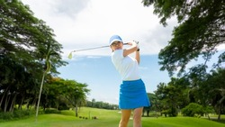 Golfer sport course golf ball fairway. People lifestyle woman playing game golf tee of blue sky background. Asia female player game shot in summer. Healthy and Sport outdoor