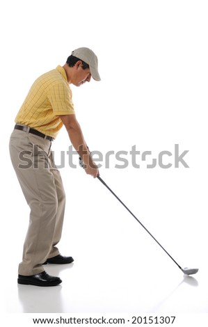 Golfer teeing off in a studio setting isolated on a white background