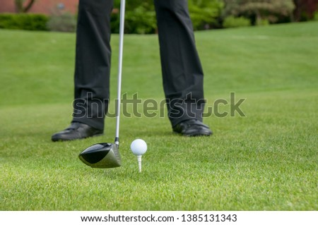 Golfer teeing off on the golf course