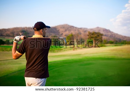 Golfer teeng of on a beautiful summer day